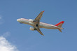 red and white commercial aircraft taking off