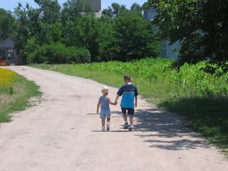 children walking down path
