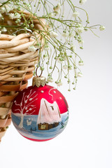 red christmas ball and basket