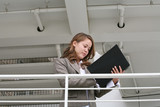 business woman reviewing notes poster