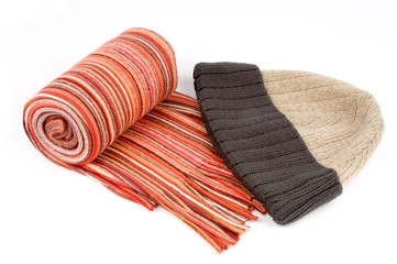 tortile multicolor wool scarf and cap over white background