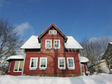 red wooden villa and snow poster