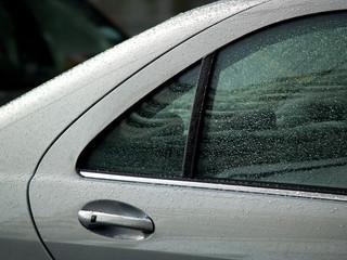 silver car in rain 02