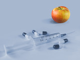 apple or pills and syringe poster