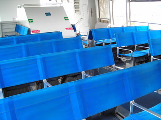 blue chairs on ship