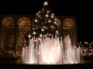 illuminated fountains and  decorated christmas tree