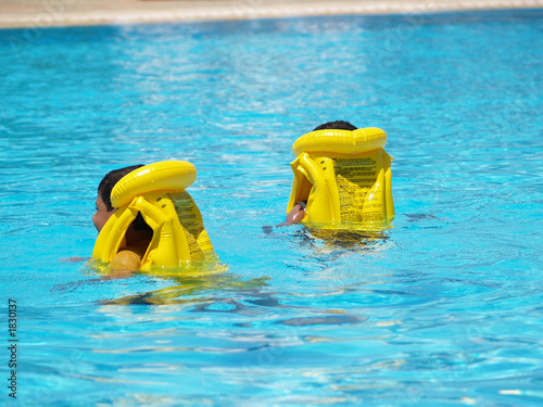 young swimmers with life vests