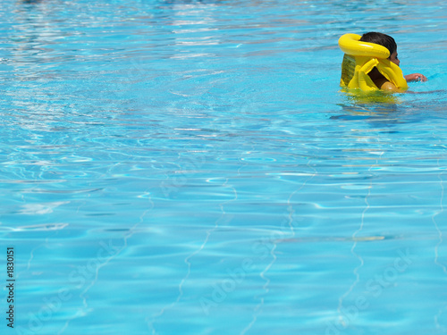 young swimmer with life vest
