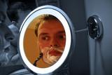 man shaving in mirror poster