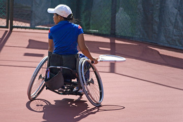 wheel chair tennis for disabled persons (women)