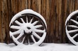 antique wagon wheels in snow