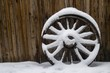 old wheel in snow