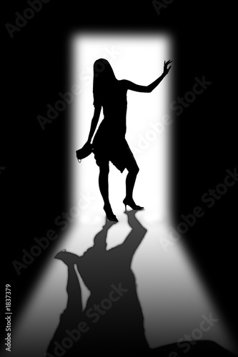 silhouette of the girl in a doorway