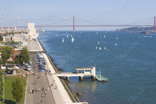 wide river with yachts and modern bridge