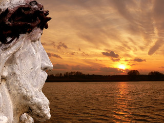 jesus looking at sunset sky