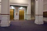 elevators in lobby with door closing poster