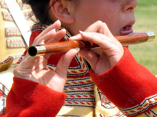 young girl playing flute in a colonial military band