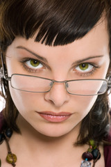 pretty brunette girl in glasses portrait