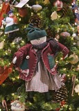 red jacket doll ornament poster