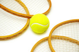 four tennis rackets and balls isolated on white