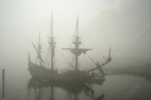 old sailship (pirate?) in the fog - 1862976
