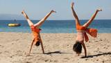 Fototapety two girls doing cartwheel