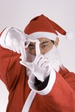 asian santa claus with framing gesture poster