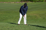 golf player ready to hit poster