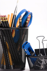 desktop baskets with pencils and clips