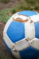 blue and white leather soccer ball