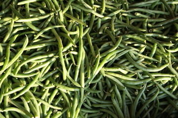 green beans at a market stall