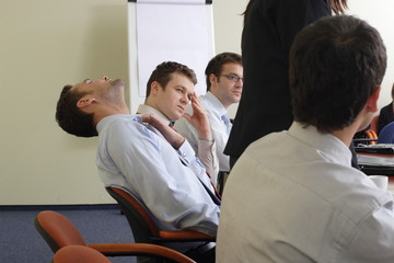 business people at boring meeting