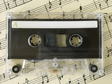 cassette on old sheet music poster