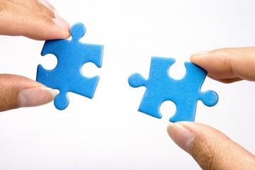 holding jigsaw puzzle