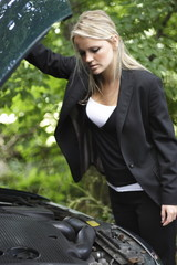 girl looking in engine bay