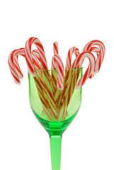 candy canes in green wine glass