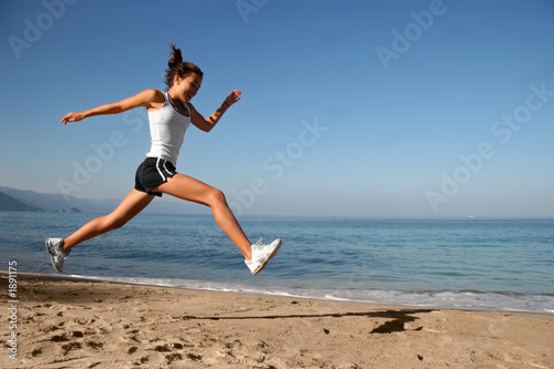 jumping on the beach