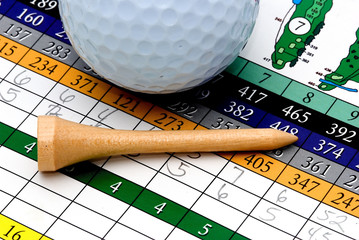 golf tee, scorecard, and ball
