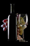 different grapes and glass of wine on black poster