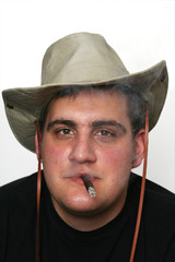 tired cowboy cigar portrait