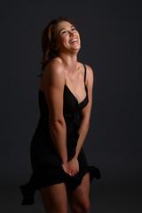 model holding down dress