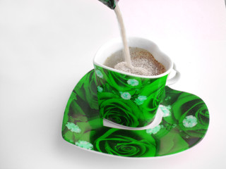 filling the green cup of coffee with heart