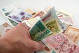 hand grasping money poster