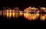christmas lights reflecting on lake poster