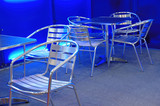 empty stainless steel chairs and tables poster