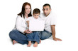 family with child on computer