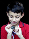 boy exuding pride over his accomplishement poster