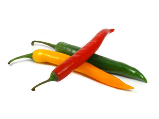 three hot pepper over white