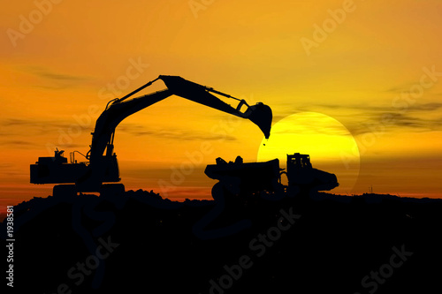 canvas print picture excavator in storm