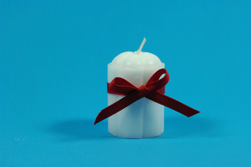 white candle with ribbon